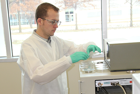 Dustin May works in the State Hygienic Laboratory Radiochemistry lab.